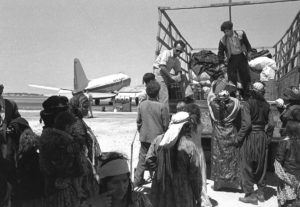 Iraqi Immigrants with Plane